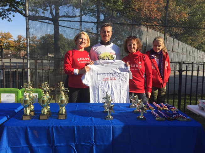 Attorney Mariusz Sniarowski posing with the trophies at the Children's Smile Foundation's annual 5K.